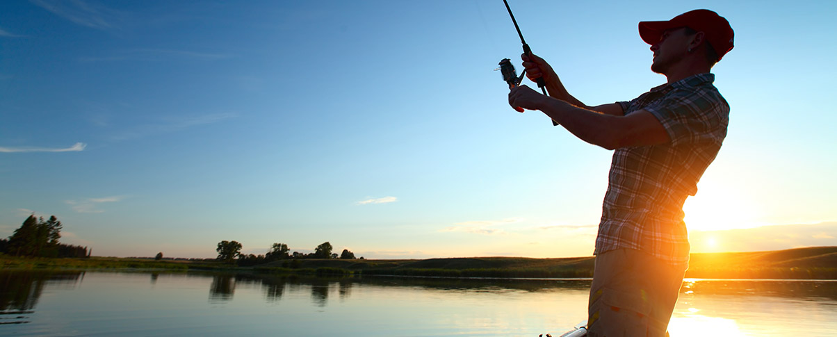 slider_0002_bigstock-Young-man-fishing-from-a-boat-52267666