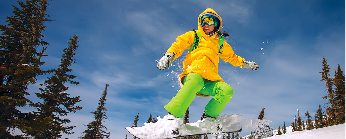 slider_0007_bigstock-Snowboarder-jumping-through-ai-58728974